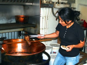 Maria Diaz in her restaurant in Odell preparing traditional carnitas from Michoacán