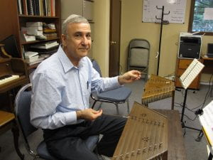 Hossein Salehi sitting at the santoor