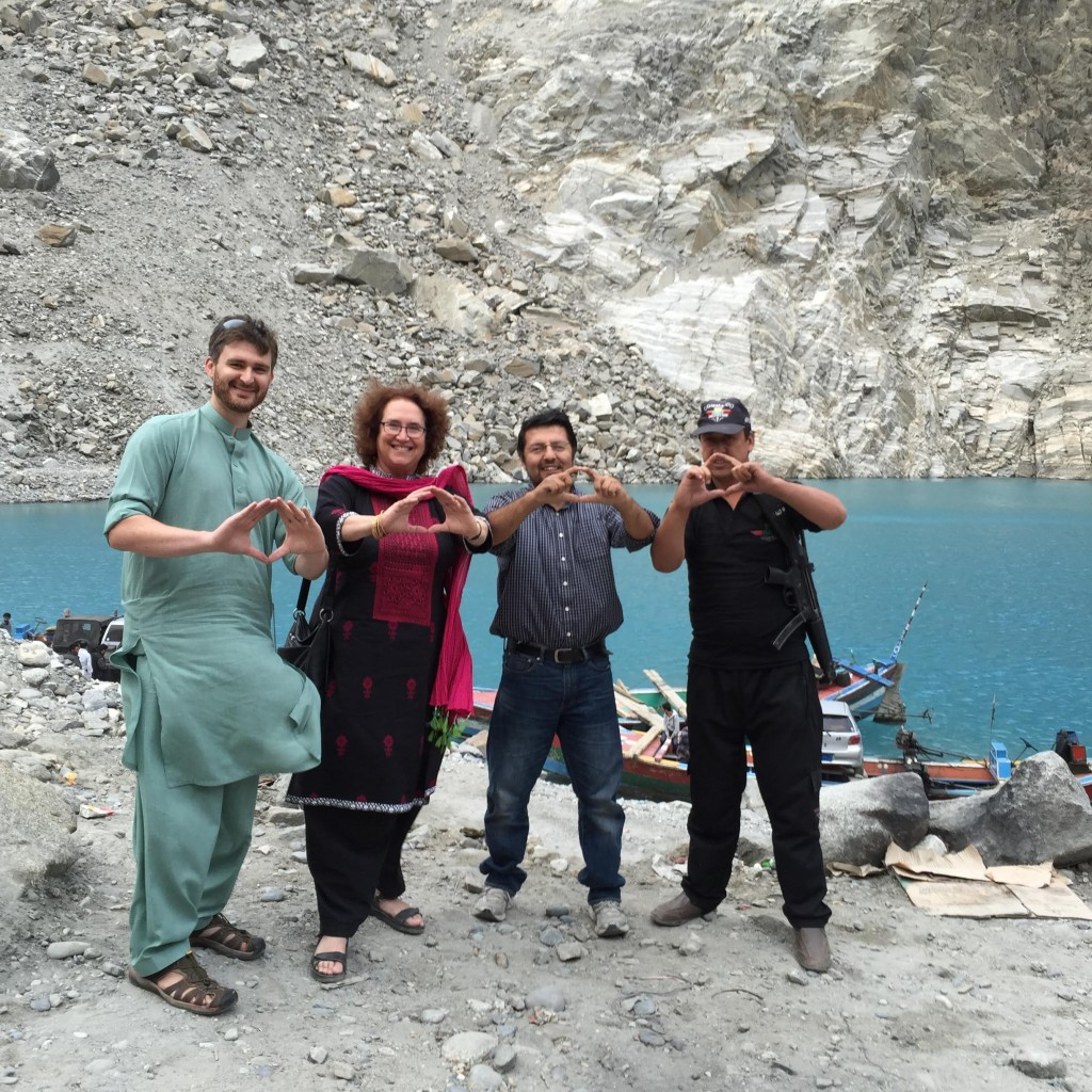 UO delegation to Karakorum International University in Gilgit, Pakistan, crossing Attabad Lake in Hunza. Formed on January 4, 2010 from a massive landslide in the Karakorum mountains, the lake submerged entire villages as well as a portion of the Chinese-built Karakorum highway (KKH). Ducks Jonathon Campbell (CAPS) and Anita Weiss (International Studies) sport the O in Shishkat with Sultan Abbas (KIU, International Relations) and their gunman Gul Abbas, haveldar (deputy) of Nagar Police station in Hunza, as their car is loaded on a wooden ferry to cross the lake at Attabad.