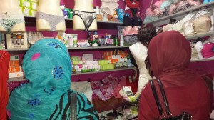Female customers in a women's accessories shop owned and run by a woman shopkeeper