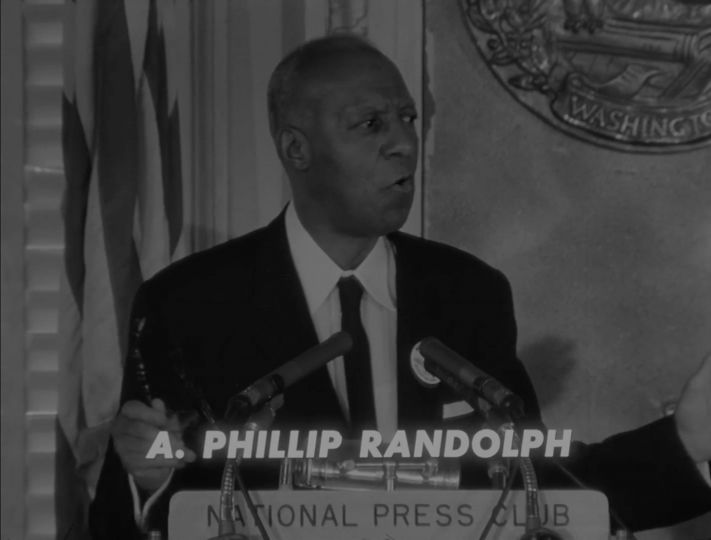 A. Philip Randolph speaks at a podium.