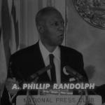 A. Philip Randolph speaks at a podium.