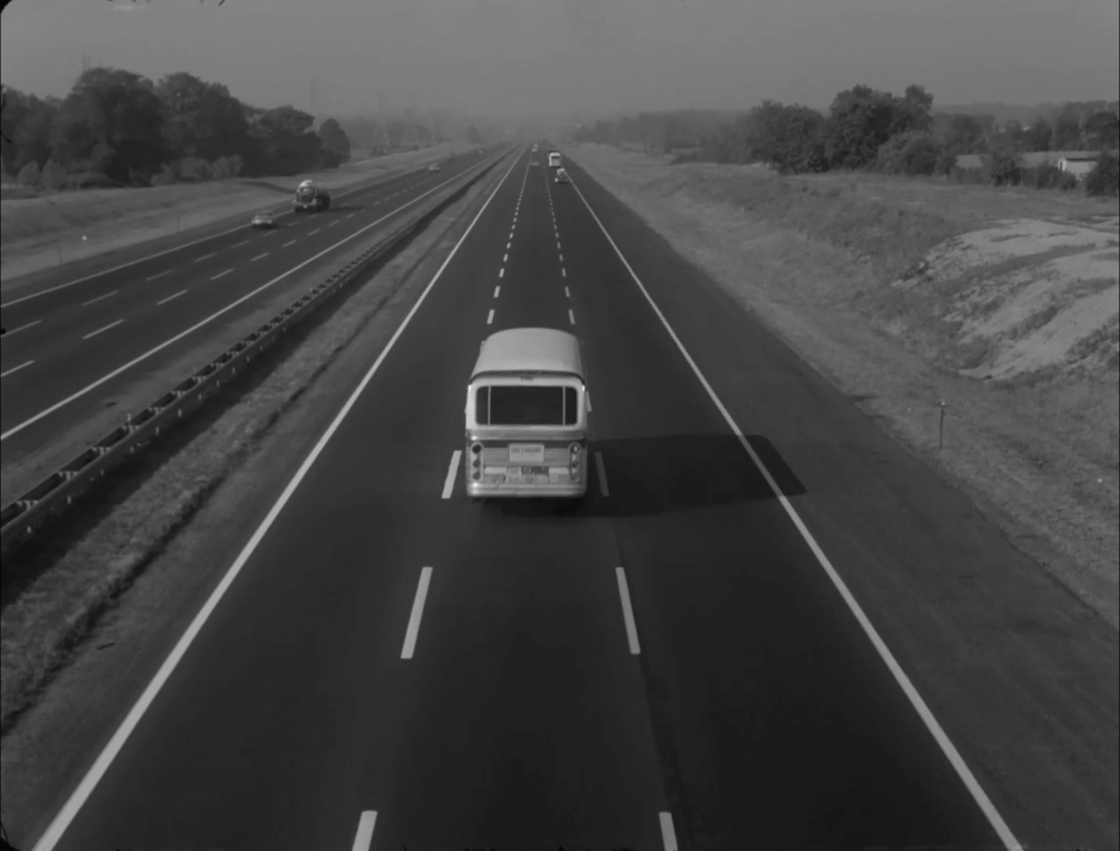 A bus drives on a highway.
