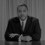 """A still from James Blue's """"The March"""", showing Carl T. Rowan."""