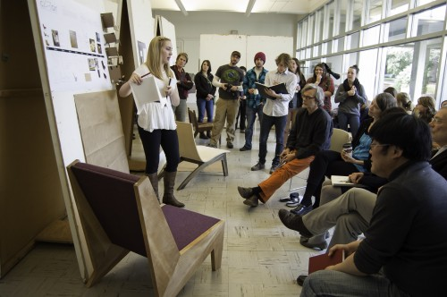 Students presented their finished chair designs one-by-one to a panel of reviewers and fellow students.