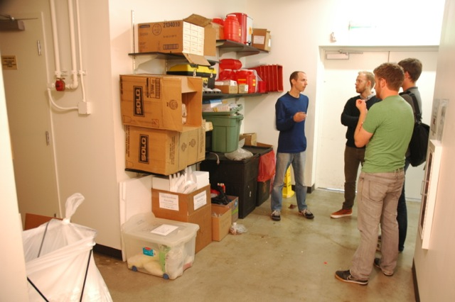 Architecture graduate students talk to a Portland-area micro-entrepreneur about his space. The students are part of the UO Portland Design Assistance | Design Build partnership. Photo courtesy Howard Davis.