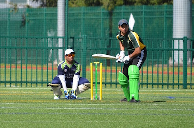 Aditya Chauhan of UO Eugene batting. Sai Prashanth of PSU Vikings wicket keeping.