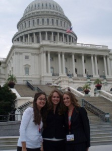 Three girls in front of the capital building