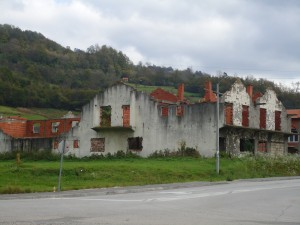 Houses abandoned and destroyed in an ethnically cleansed town on the way to the Srebrenica memorial.