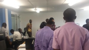 Everyone gathering around to pray before eating