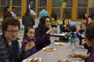 Families and Mentors enjoy  a nice dinner