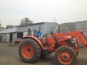 Jonah Rodewald ('19) pilots the Tribal Native Plants Nursery tractor on a mission to eradicate weeds.