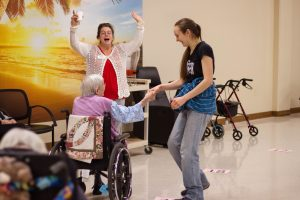 Student dances with their grandparent at the annual Adopt-A-Grandparent Valentine's Party