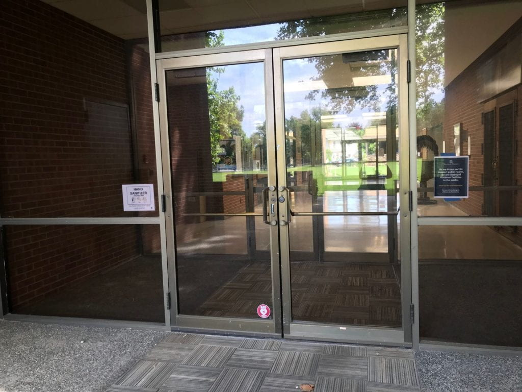 Glass doors at the entrance to Olin Hall