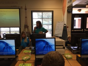 Mrs. Webb co-teaches with Mrs. Baker. Here she is helping 6th graders set their passwords at the beginning of the school year.