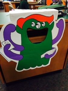 Students feed books to our monster!
