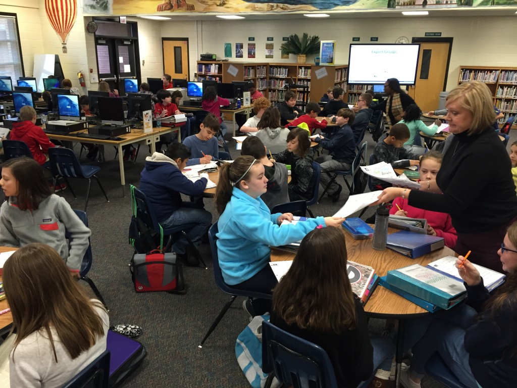 6th grade students collaborate in their expert groups to plan their project goals.