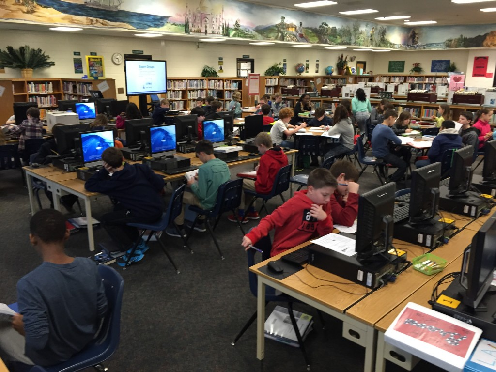 Students utilize the media center computers as they implement technology into their project plans.