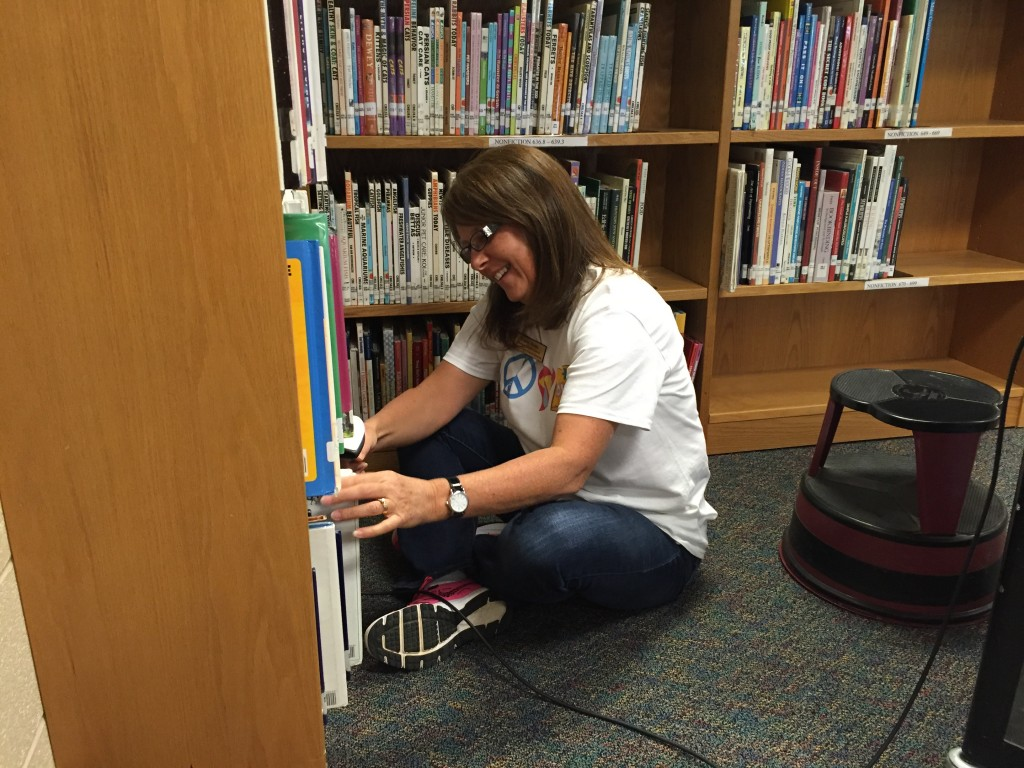 During annual inventory, Mrs. Webb scans every single item in the media center to verify its location.
