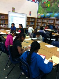 Students learning how to write bibliographies.