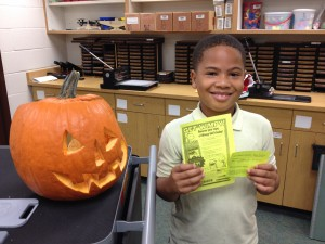This student guessed that the pumpkin had 505 seeds.  His guess came the closest to the actual number of seeds in the pumpkin:  510.  He won the new Diary of a Wimpy Kid:  The Long Haul as his prize!