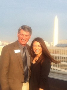 Jackie Newland and her father Joe, pose for a photo   with the Washington Memorial in the background.