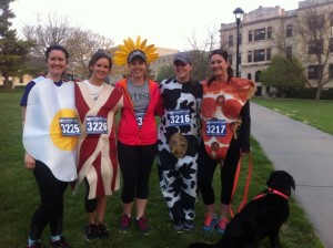 Graduate students and their four-legged friend participated in the Farm to Fork 5K.