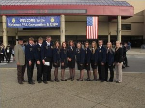 Tara Gildden poses for a picture with her FFA students.