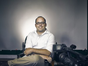 New hire at the Center for Rural Enterprise Engagement, Scott Stebner, sits in his office turned film studio.