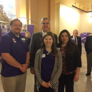 Rep. Tom Phillips visits with Shawn Finch, Jessica Leichter and Amanda Morales at Cats in the Capitol.
