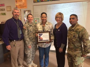 Eunice Rivera, teacher and veteran, is one of four MHS teachers presented with an Education Salute award. Manhattan High  principal Greg Hoyt, First Lt.  Jessica Deason, Tonnie Martinez and First Lt. Anthony Magallanes, presented the awards.
