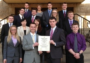 Deeter with students at installation of Pi Sigma Epsilon