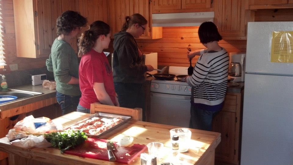 A group of german students and professor making Frikadelle (meat dumplings)