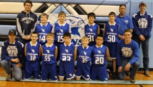 Will Clark, with a junior high basketball team he coaches.
