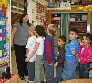 A teacher lines up students for a drill