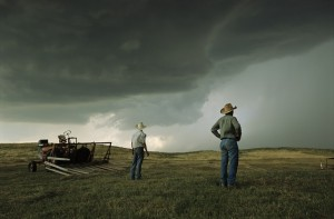 Ranchers watch approaching thunderstorm in the Sandhills of Nebraska.