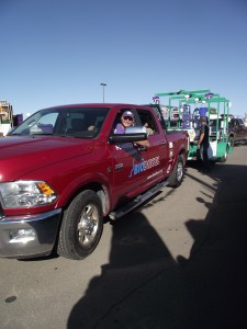 Bill Spiegel pulling the Recycling float for K-State's Homecoming parade.