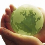 green globe in hands