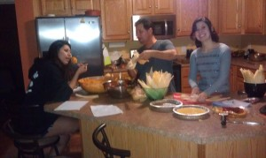 Pedro making tamales with daughters Ana and Valeria.