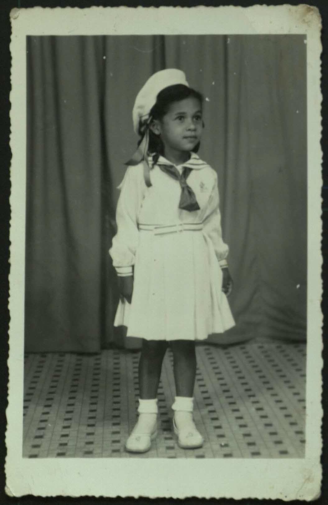 5-year old Rita in a religious school uniform.