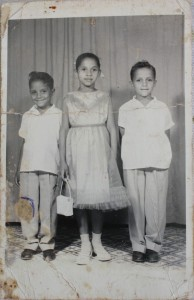 8-year-old Rita with her brothers in La Romana, Dominican Republic.