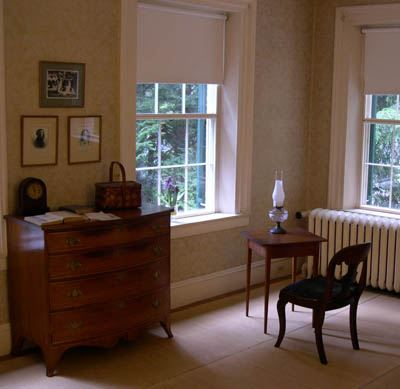 Dickinson's room with three portraits