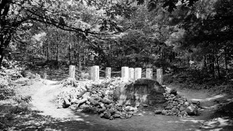 Posts, a plaque, and a rock cairn mark the site of Thoreau's cabin near the shore of Walden Pond. J. Walter Green / AP