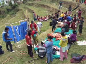 Staff from Gaurishankar Hospital attend to injured patients on the grass outside the hospital several days after the earthquake.