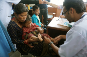 Dr. Dangal providing treatment to earthquake victims (https://planasia.exposure.co/this-mothers-day-meet-the-new-moms-after-the-nepal-quake).