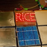 "Ceramic tiles coated with battery paints and then heat-sealed powered LEDs spelling out ""RICE"" for six hours in an experiment at Rice University. The lithium-ion batteries can be painted on virtually any surface. Photo by Jeff Fitlow"