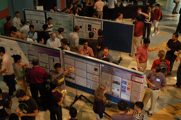 Rice students and postdoctoral researchers displayed and discussed their posters at the Rice Quantum Institute's summer colloquium.