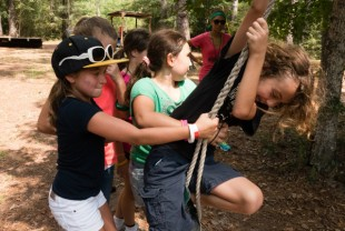 Camp Kesem campers enjoy the low ropes course.
