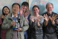 Students enrolled in the Photography in China course got to display their Owl sign overseas during spring break.