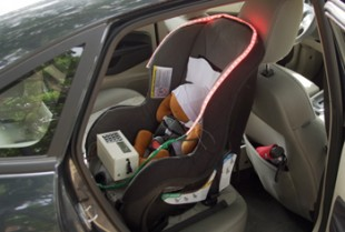 The Infant SOS device installed in a car with visual alerts flashing.